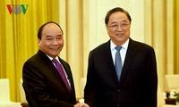 Нгуен Суан Фук встретился с председателем Народного политического консультативного совета КНР