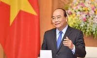 Premier vietnamita invita a los compatriotas en ultramar a unirse a la lucha contra el coronavirus