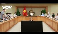 Vu Duc Dam dirige une réunion sur les essais de vaccins anti-Covid-19