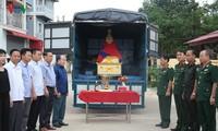 Đưa hài cốt 12 liệt sĩ quân tình nguyện Việt Nam hy sinh tại Lào về nước