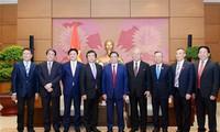 越日友好议员小组主席范明正会见日本海洋政策担当大臣福井照