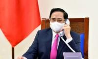 นายกรัฐมนตรี ฝามมิงชิ้งพูดคุยผ่านทางโทรศัพท์กับนายกรัฐมนตรีญี่ปุ่น
