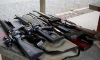 New Zealanders give up guns after massacre