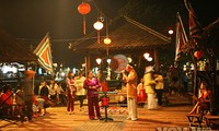 Enjoying Hoi An's folk songs, dances, and games