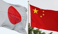 Top leaders of Japan, China affirm closer ties in first talks