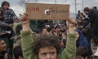 Greece vows to defuse migrant camp in a week