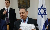 Israel vows to work with US on peace efforts