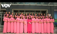 "Women donning ""ao dai"" shine at work"