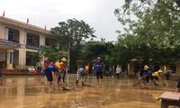 Arbeit zur Beseitigung von Flutfolgen in Provinzen in Zentralvietnam