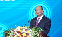 PM vows to minimize risk for businesses