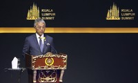 Malaysia's king calls on parties to work together in search for new PM  