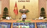越南政府总理范明政与各地举行新冠肺炎疫情防控工作会议