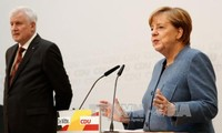 German Chancellor sets date to start coalition talks