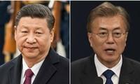 Moon Jae-in et Xi Jinping vont œuvrer à la signature d'un traité de paix mettant fin à la guerre de