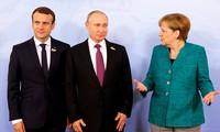 Échange téléphonique entre Emmanuel Macron, Angela Merkel et Vladimir Poutine