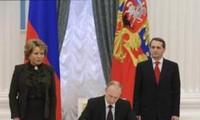 Presiden Rusia V.Putin memberlakukan Undang-Undang tentang penggabungan Krimea