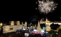Nuit de Noël pour les chrétiens à Bethléem, Jérusalem et au Vatican