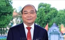 越南国家主席阮春福赞扬新冠肺炎疫情防控战线上的新闻工作者