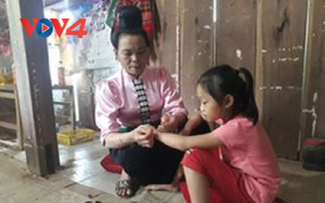 Thai people tie thread bracelets to pray for heath, peace