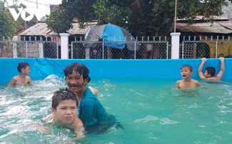 Local swimming coach honored by Forbes Vietnam
