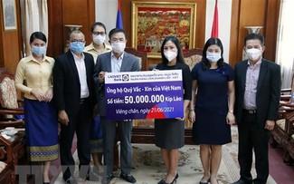 Cộng đồng người Việt tại Lào tiếp tục ủng hộ cuộc chiến chống dịch COVID-19 tại quê nhà