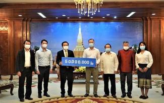 Thủ đô Vientiane (Lào) chia sẻ khó khăn với thành phố Hà Nội và Thành phố Hồ Chí Minh chống dịch COVID-19