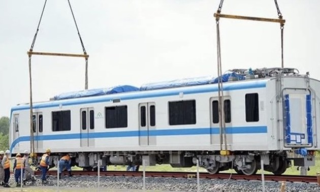 Train carriages of HCM City's first metro line installed onto trial track