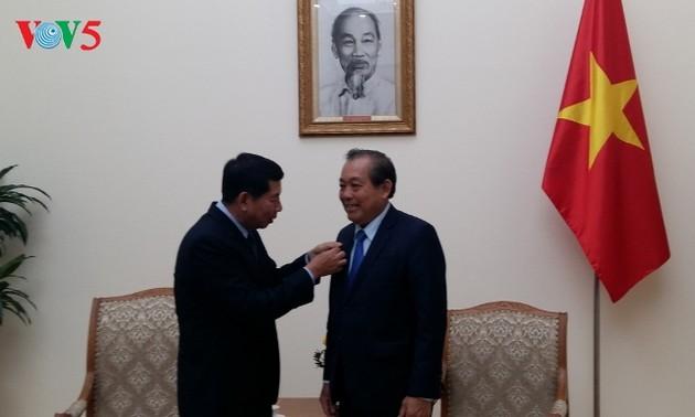 Phó Thủ tướng Thường trực Trương Hòa Bình tiếp Chánh án Tòa án nhân dân tối cao Lào
