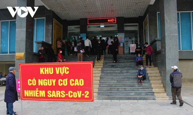 Vietnam activates stronger COVID-19 alert system as 82 more cases tested positive