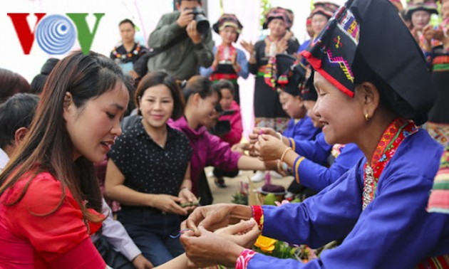 Thread bracelet tying custom of ethnic people in Vietnam's northern mountains