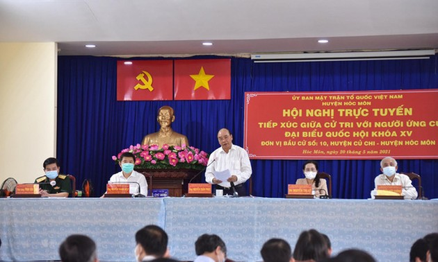 President, National Assembly candidates meet voters in HCMC
