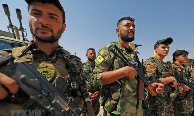 Kurds withdraw from northern border areas of Syria