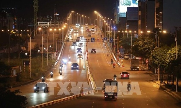 Hanoi narrows locked-down areas to recover business, production