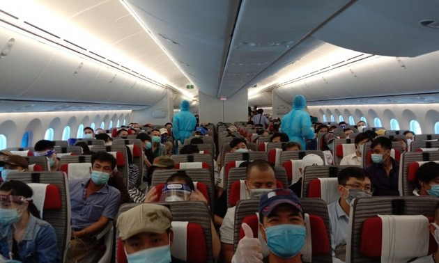 Vietnamese expats return home from Russia, Mozambique, Norway
