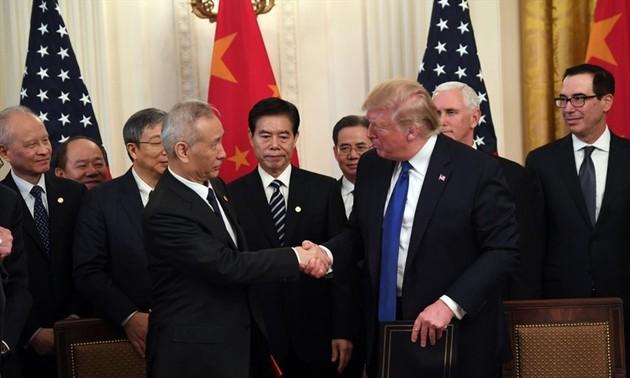 Estados Unidos y China acuerdan seguir adelante con su pacto comercial