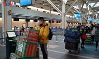 Vietnamese citizens return home from Canada, South Korea