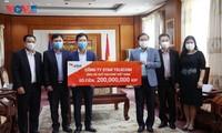 Các địa phương, doanh nghiệp tại Lào ủng hộ 30.000 USD giúp Việt Nam chống dịch