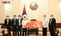 ชมรมชาวเวียดนามที่อาศัยในประเทศลาวร่วมมือกับทางการท้องถิ่นป้องกันการแพร่ระบาดของโรคโควิด – 19
