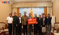 Người Việt tại Lào chung tay hỗ trợ người dân tỉnh Savannakhet khắc phục hậu quả lũ lụt