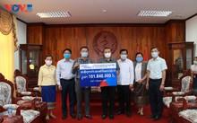 Cộng đồng người Việt tại Lào cùng chính quyền sở tại phòng chống COVID-19