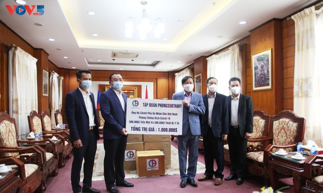 Doanh nghiệp Lào ủng hộ 1 triệu USD giúp Việt Nam chống dịch