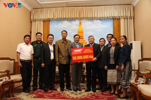 Người Việt tại Lào chung tay hỗ trợ người dân tỉnh Savannakhet khắc phục hậu quả lũ lụt - ảnh 1
