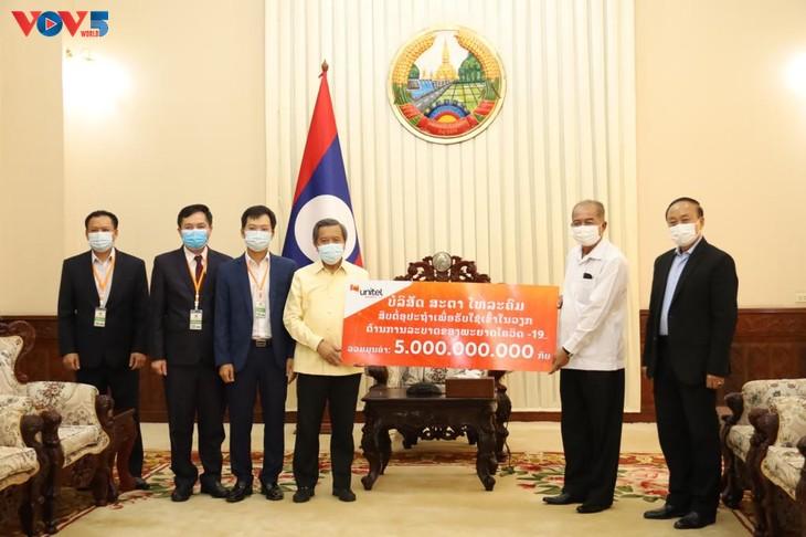 Cộng đồng người Việt tại Lào cùng chính quyền sở tại phòng chống COVID-19  - ảnh 1