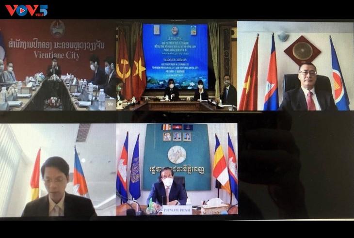 Thành phố Hồ Chí Minh trao quà hỗ trợ thủ đô Phnom Penh và Vientian - ảnh 1
