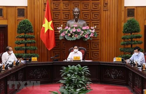 Reunión ordinaria del Gobierno vietnamita sobre el trabajo anticovid-19 - ảnh 1