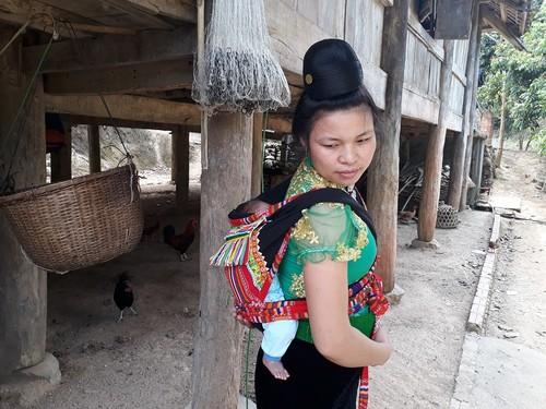 Adat  Merayakan Bayi Berusia Sebulan dari Warga Etnis Minoritas Thai di Provinsi Son La - ảnh 2