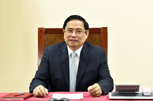 越南政府总理范明政与法国总理通电话 - ảnh 1
