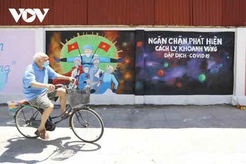 Murales de propaganda sobre la respuesta al covid-19 en Hanói - ảnh 10