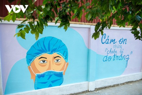 Murales de propaganda sobre la respuesta al covid-19 en Hanói - ảnh 11
