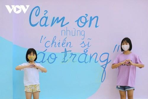 Murales de propaganda sobre la respuesta al covid-19 en Hanói - ảnh 12